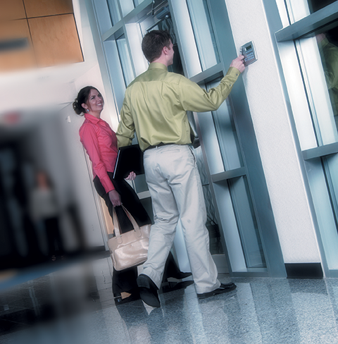 This is an image of employees using a security system.